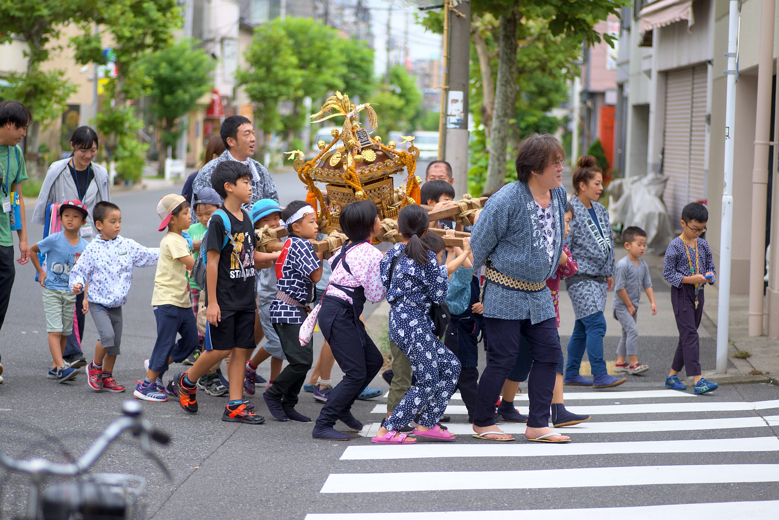 Children carrying a mikoshi